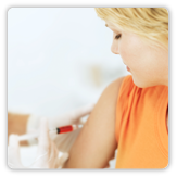 Photo of a woman getting a shot in her arm